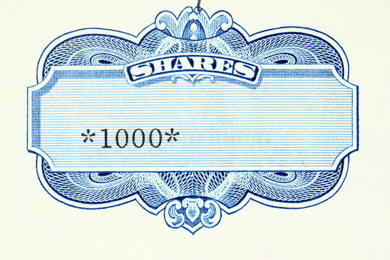 Shares. One thousand shares - close up of a vintage stock market object. Obsolete corporate shares certificate stock photos
