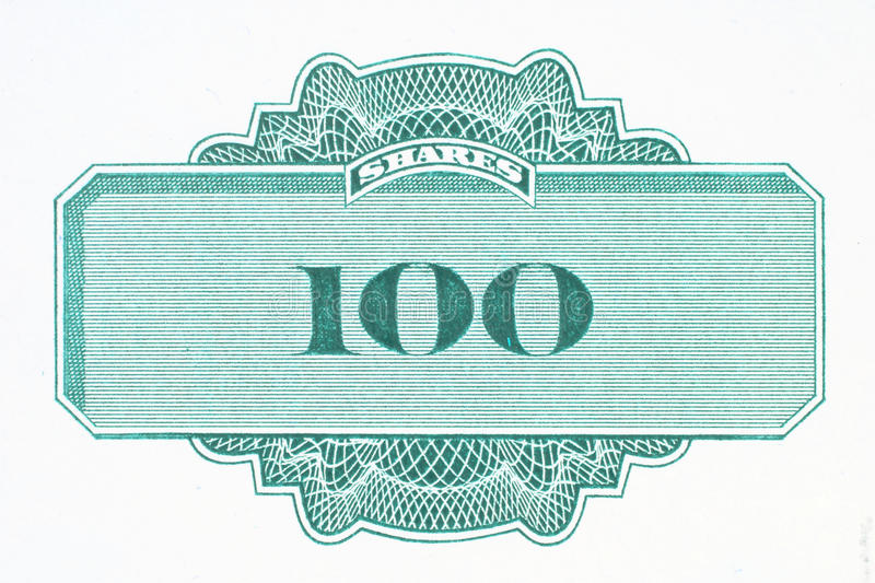 Shares. Hundred shares - close up of a vintage stock market object. Obsolete corporate shares certificate stock image