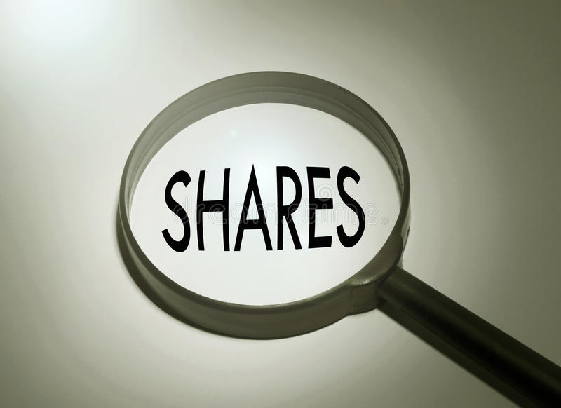 Shares. Magnifying glass with the word shares royalty free stock images