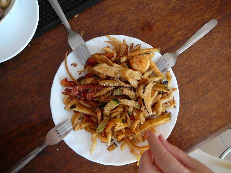 Sharing a dish royalty free stock image