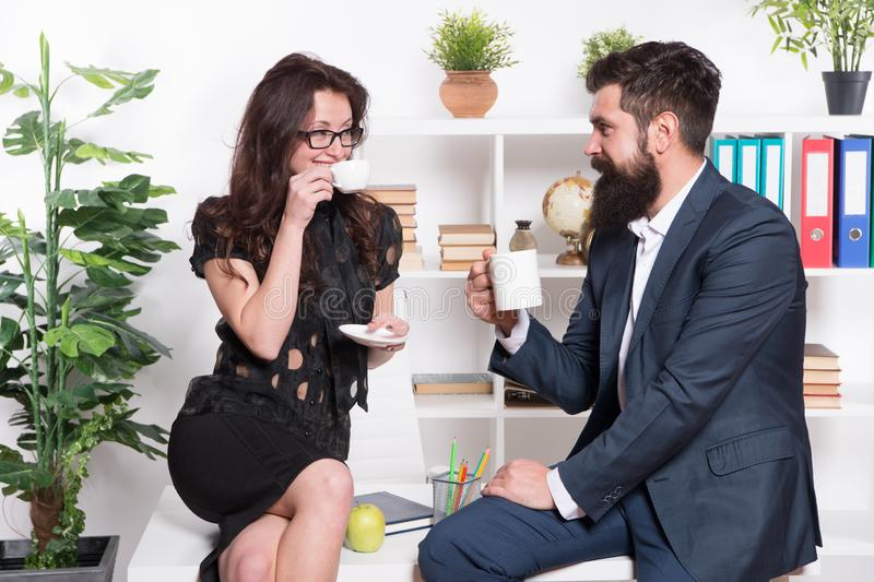 Sharing experience with colleague. Partnership and collaboration. Business couple drink coffee. Coffee time. Coffee stock photo