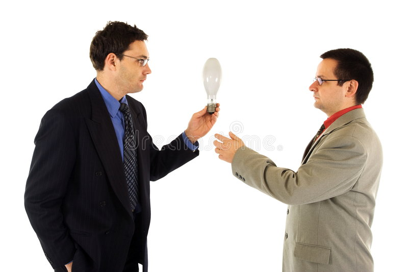 Sharing/giving idea. Businessman sharing an idea with his colleague royalty free stock images