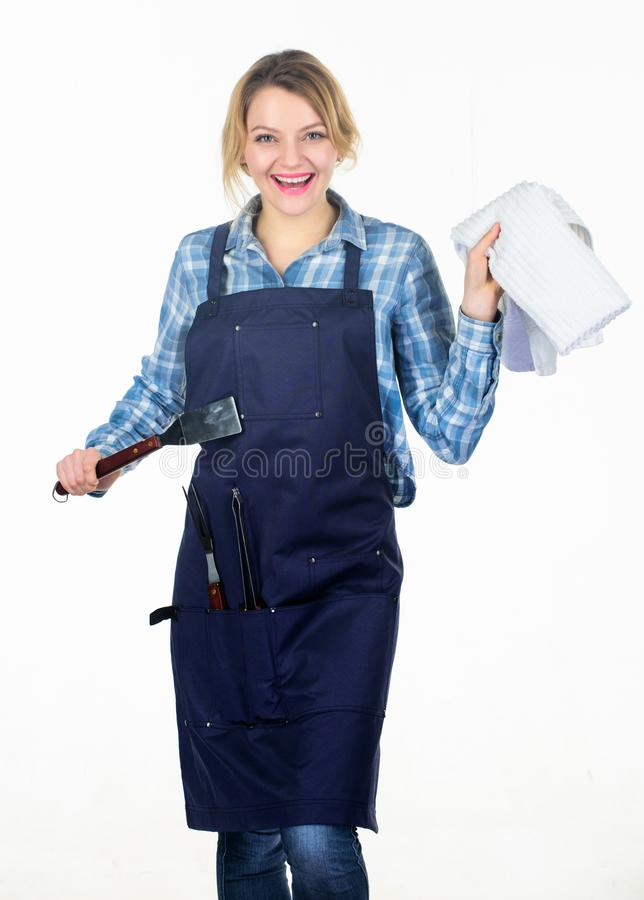Sharing good time. Family weekend. Pretty girl in chef apron. Preparation and culinary. Tools for roasting meat outdoor stock photos