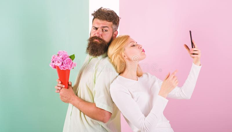 Sharing happy selfie. Woman capturing happy moment boyfriend bring bouquet flowers. Couple in love bouquet dating. Celebrate anniversary relations. Capturing stock image