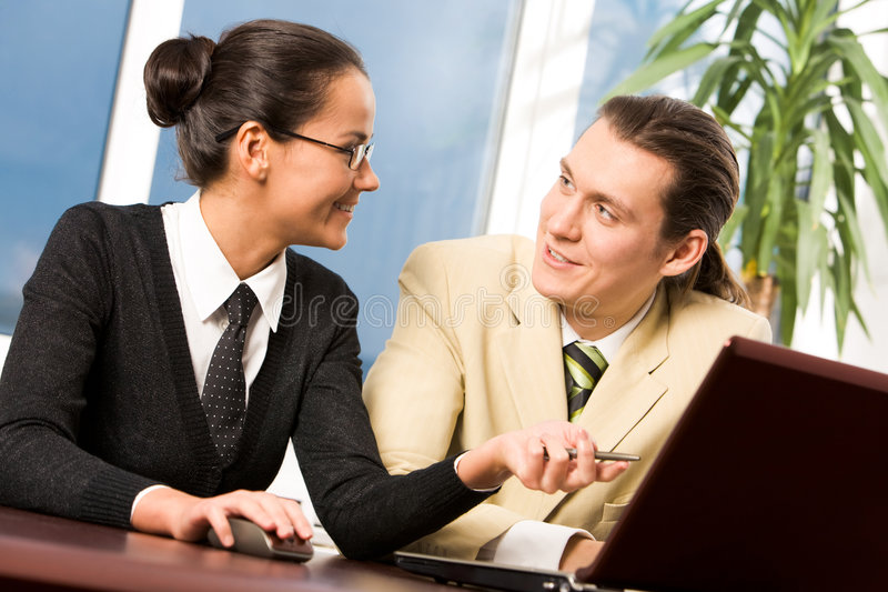 Sharing ideas. Image of busy people chatting in office at meeting stock images