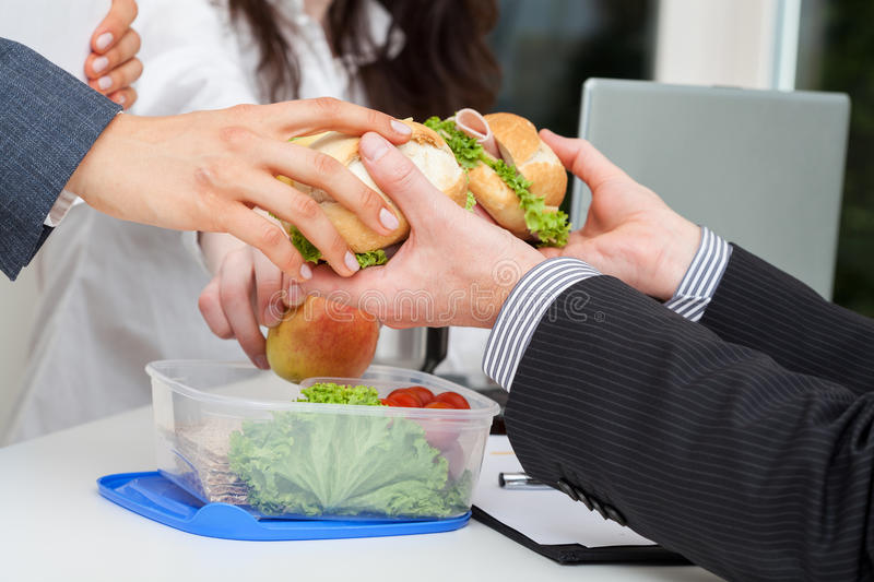 Sharing lunch in the office royalty free stock image
