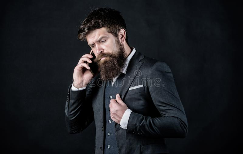 Sharing new ideas. brutal caucasian hipster use new technology. online and agile. businessman in suit. Mature hipster royalty free stock photography