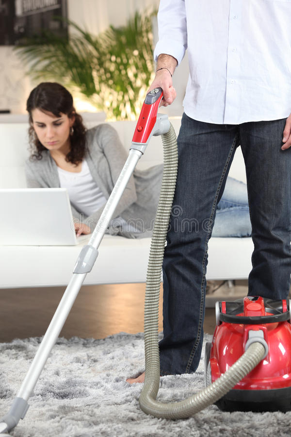 Sharing out of chores. Couple sharing out of chores stock image