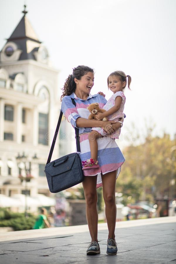 Sharing a perfect day together. Happy mother with smiling daughter on city street. Copy space royalty free stock photo