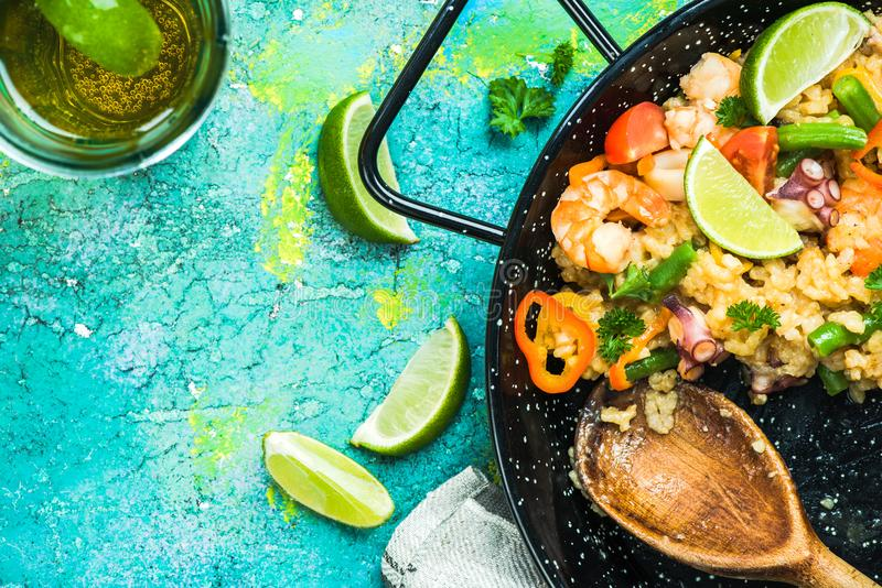 Sharing seafood spanish paella with friends stock photos