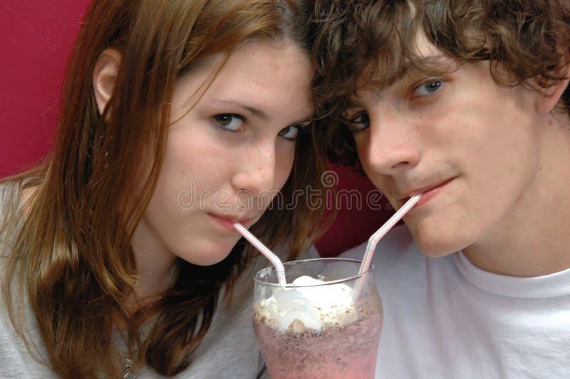 Download Sharing a sip stock image. Image of milkshake, innocent - 1132135