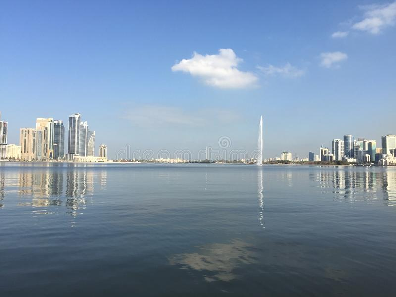 Sharjah corniche at dawn showing calm waters. Sharjah corniche at dawn showing calm royalty free stock photos