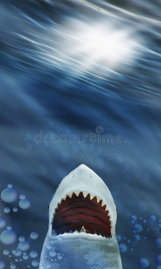 Shark. A wide open mouth of a great white shark rises from the ocean floor toward a light on the surface stock photo