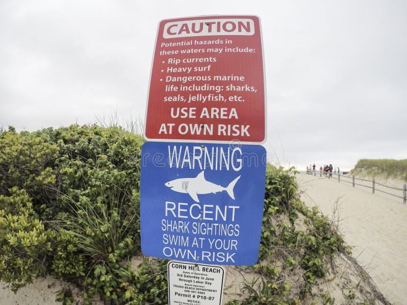 Shark warning signs at entrance to beach stock photos