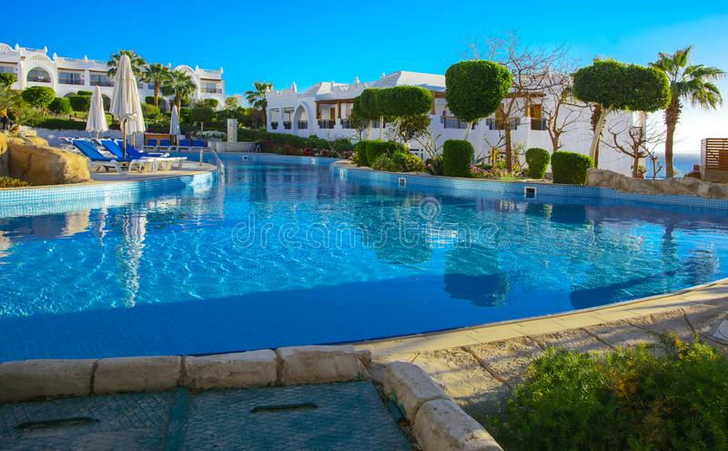 Beautiful pool in Cyrene Grand Hotel. Sharm el-Sheikh, Egypt - March 14, 2018. Beautiful pool in Cyrene Grand Hotel with clear blue water on the background of royalty free stock images