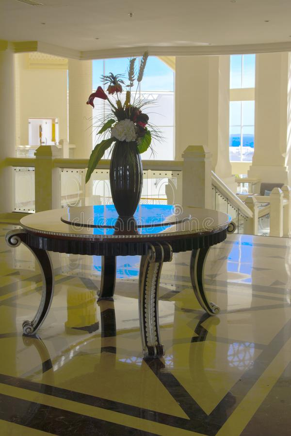 Sharm el-Sheikh, Egypt - March 14, 2018. The interior of the hotel lobby with reception, marble floor, showcases, a beautiful ston. E table with a vase of royalty free stock photo