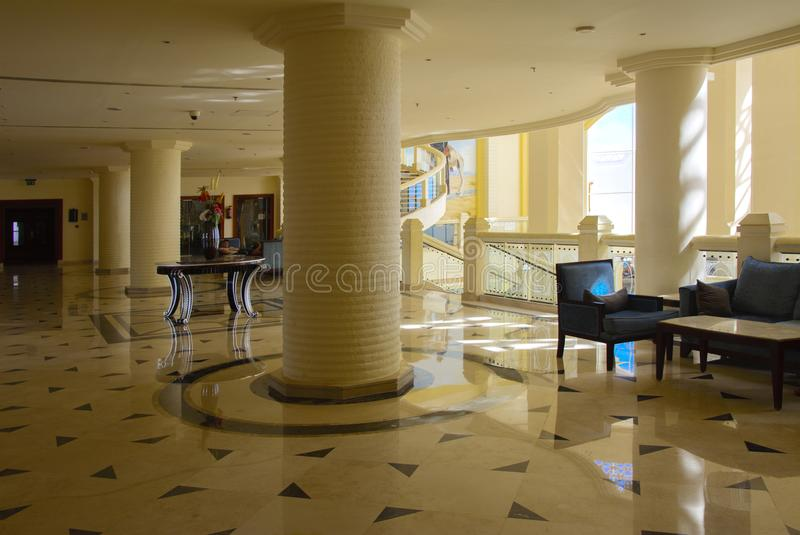 Sharm el-Sheikh, Egypt - March 14, 2018. Interior of the hotel lobby with reception, marble floor and storefronts. Accommodation in Cyrene Grand Hotel stock image