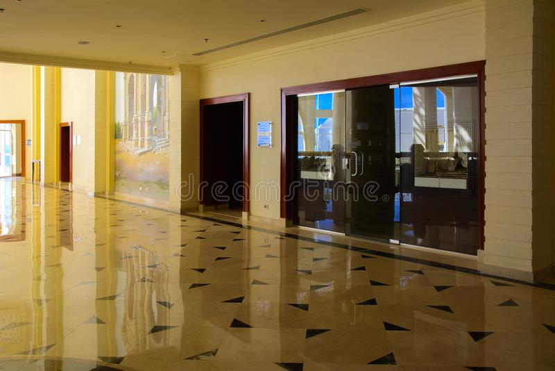 Sharm el-Sheikh, Egypt - March 14, 2018. Interior of the hotel lobby with reception, marble floor and storefronts. Accommodation in Cyrene Grand Hotel stock photography