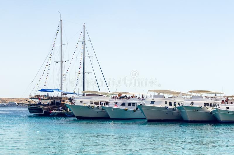 Sharm El Sheikh, Egypt May 08, 2019: Tourist pleasure boats in the harbor of Sharm El Sheikh, boarding tourists on a sea vessel royalty free stock photo