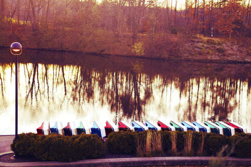 Sharonwoods park paddleboats next to the river at sunrise. Sunrise, river, paddleboats lined up stock photo