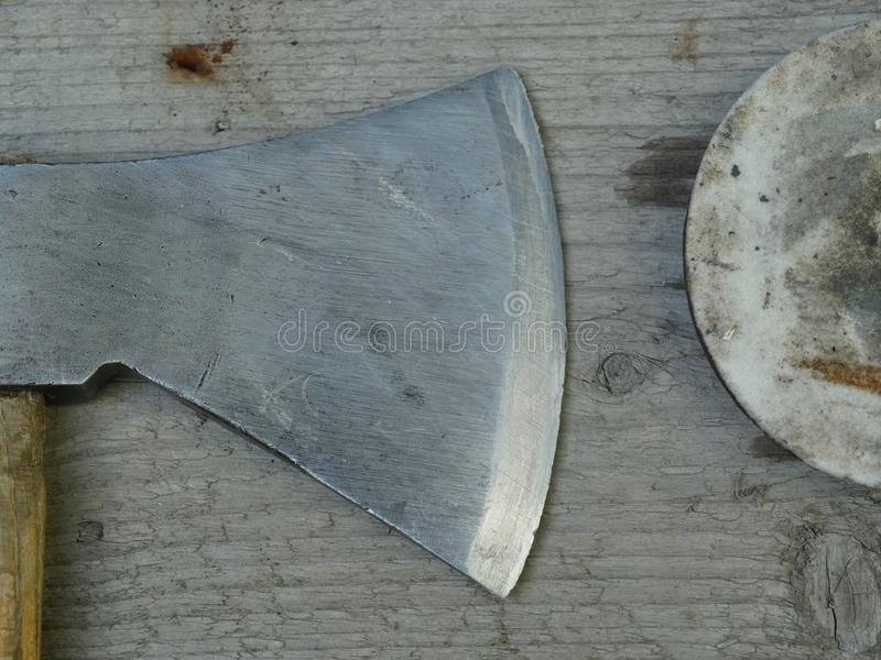 Sharp ax blade. And round sharpened royalty free stock photos