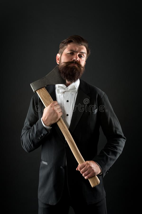 Sharp ax hand confident guy. Masculinity and brutality. Barbershop hairstyle. Brutal barber. Brutal manners royalty free stock images