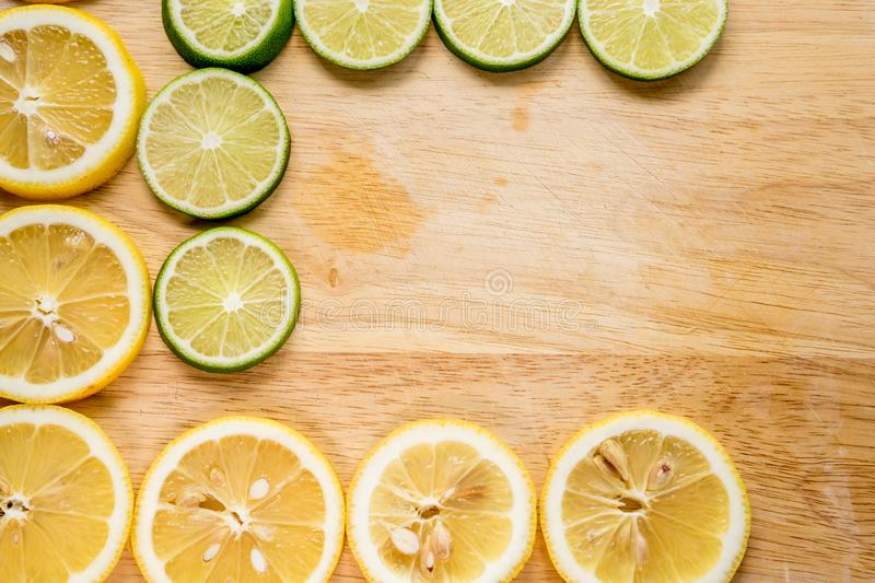 Sharp and contrast image of lemon slice. Top view to fresh organic lemon slice isolated on wood cutting board with clipping path. stock image