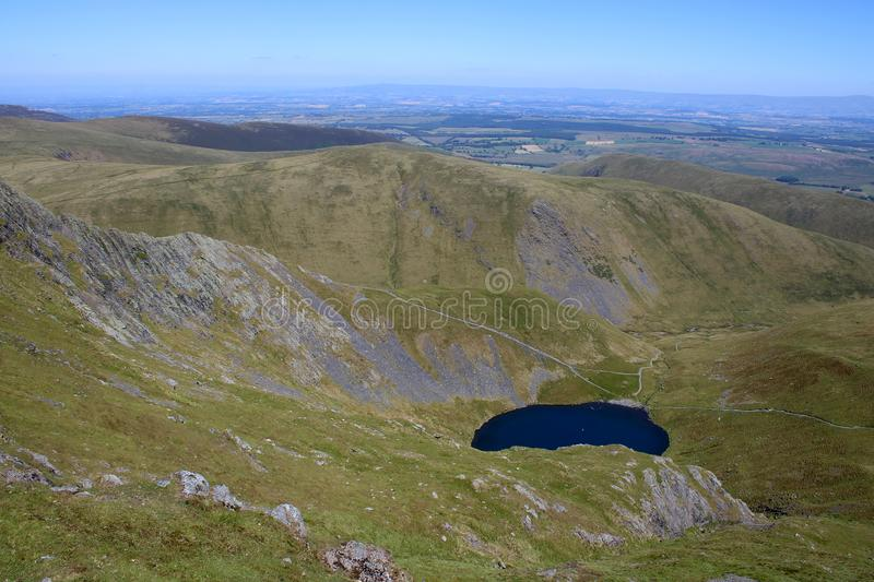 Sharp Edge, Scales Tarn, Blencathra, Cumbria, UK. View down to Scales Tarn from slopes of Blencathra also known as Saddleback in the English Lake district stock photo