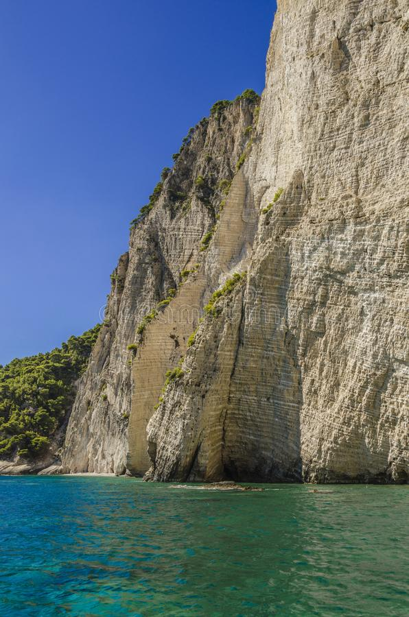 Sharp fall. Abrupt fall of reefs over the clear waters of the Ionian sea on the island of zakynthos royalty free stock photo