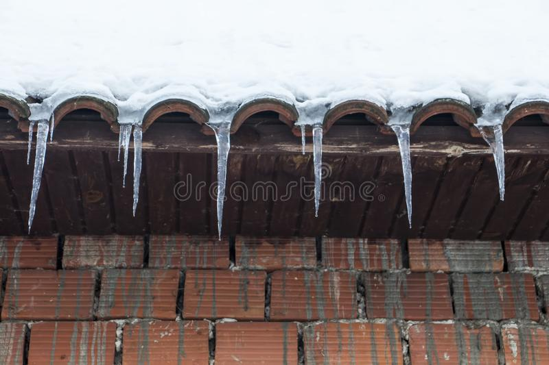 Icicles from roof royalty free stock images