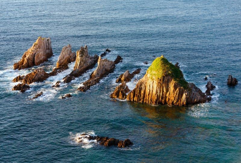 Sharp islets. Asturias, Spain. Sharp islets near Gueirua beach (Asturias, Spain). Evening Atlantic ocean landscape royalty free stock images