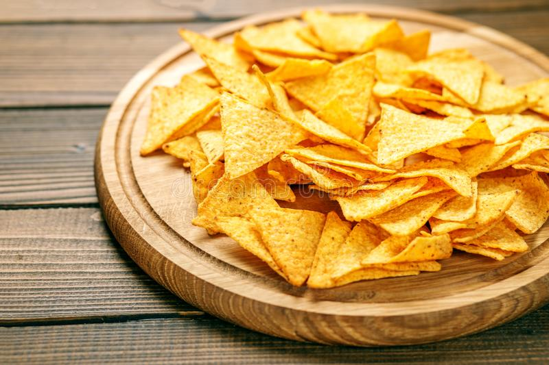 Sharp Mexican Nachos Chips. Concept - bad food, cafe, pub, party royalty free stock photos