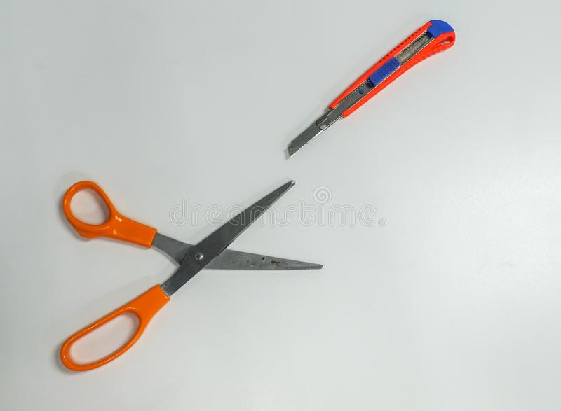 Harp objects of scissors and cutter as office stationary royalty free stock images