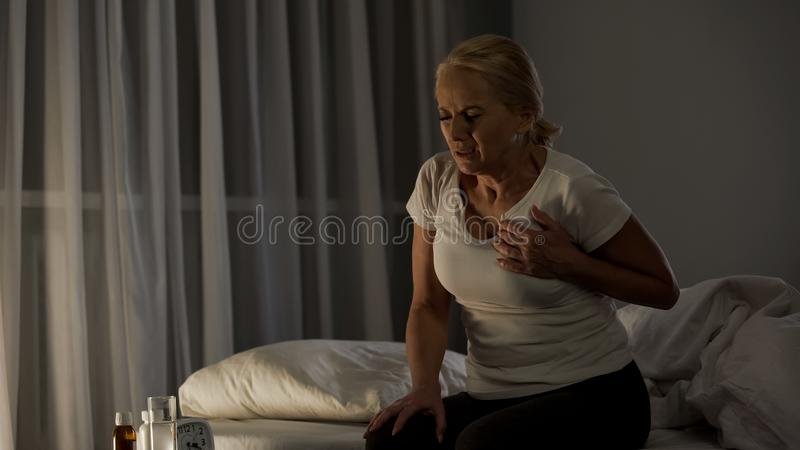 Sharp pain piercing heart of elderly woman, attack of infarction, emergency. Stock photo royalty free stock photos