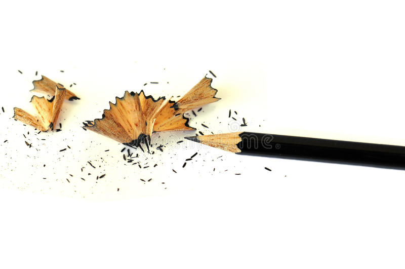 Sharp pencil background. Sharp graphite pencil and shavings on white background stock image