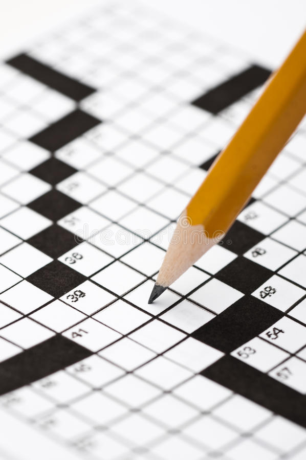Download A Sharp Pencil On A Crossword Puzzle Stock Image - Image: 10798089