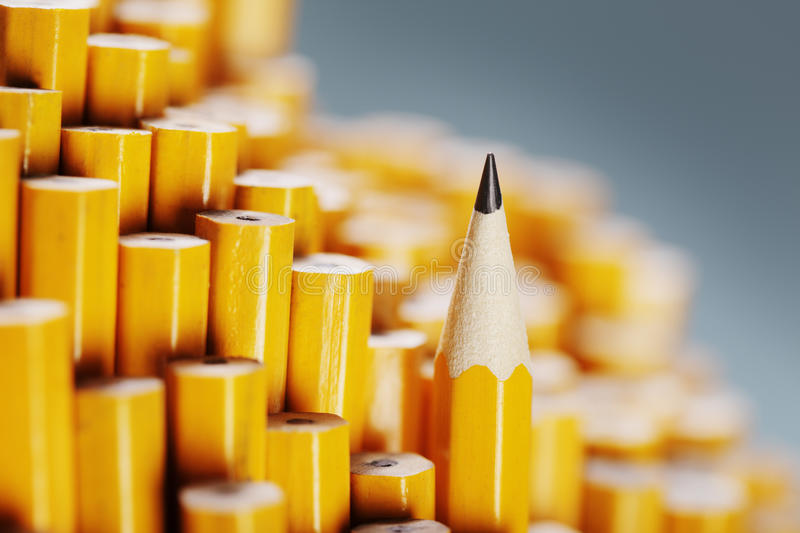 Sharp Pencil. One sharpened pencil standing out from the blunt ones stock photo