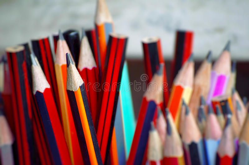Sharp Pencil. Sharpened pencil standing out from the blunt stock photography