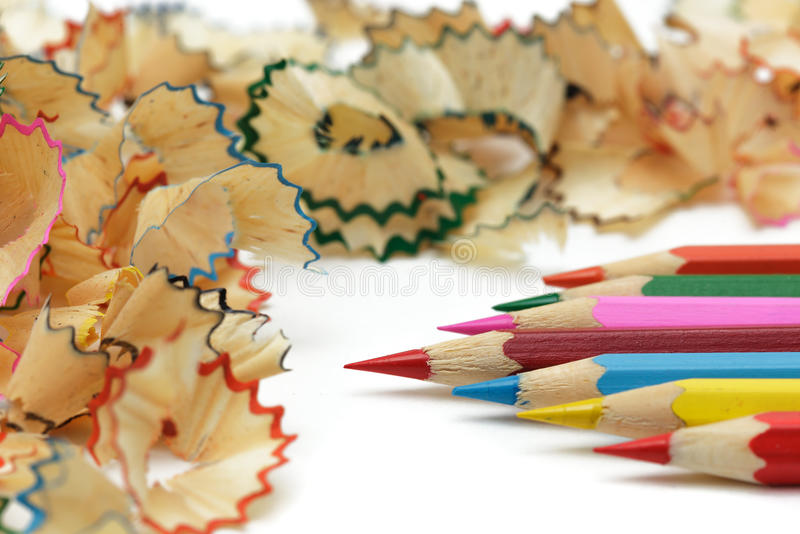Sharp pencil with shavings lie on the office desk royalty free stock photos