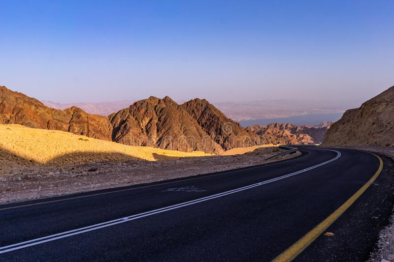 Road to Eilat from the west. Eilat mountais and the Aqaba gulf stock images