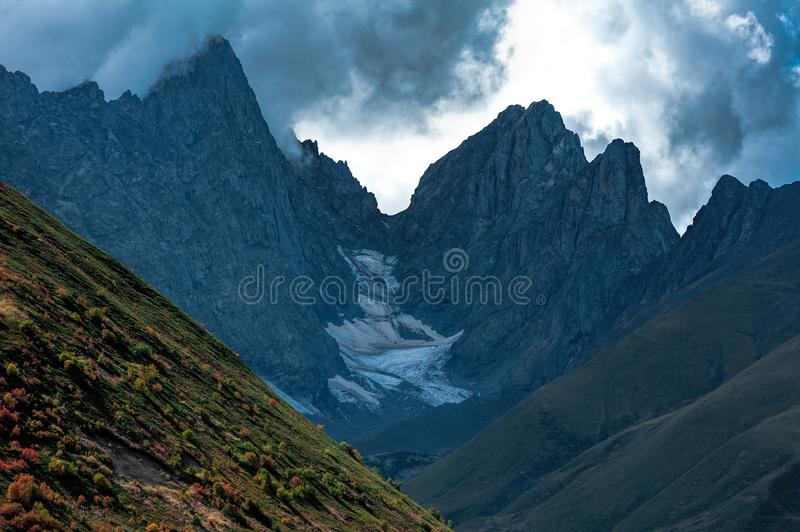 Sharp Roshkakhori mountain peaks in the clouds stock photography