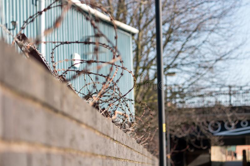 Razor Wire. The sharp and rusty razor wire on top of the wall stock images