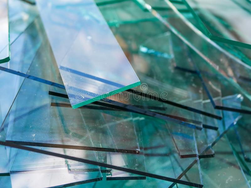 Sharp sheet glass waste waiting the transport back to the factory royalty free stock photo
