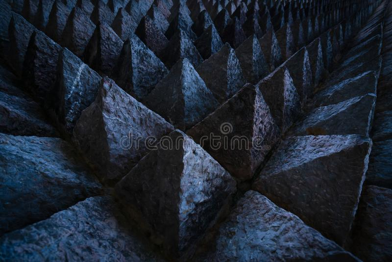 Sharp tip concrete architecture texture background. Art picture of unique pattern of dark stone carving in pointed triangle shape. stock photography