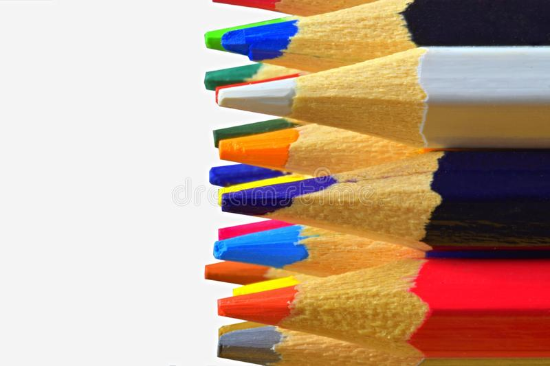 The sharp tips of the pencils. Bright colored pencils. Colored pencils on white background with selective focus. Write royalty free stock images