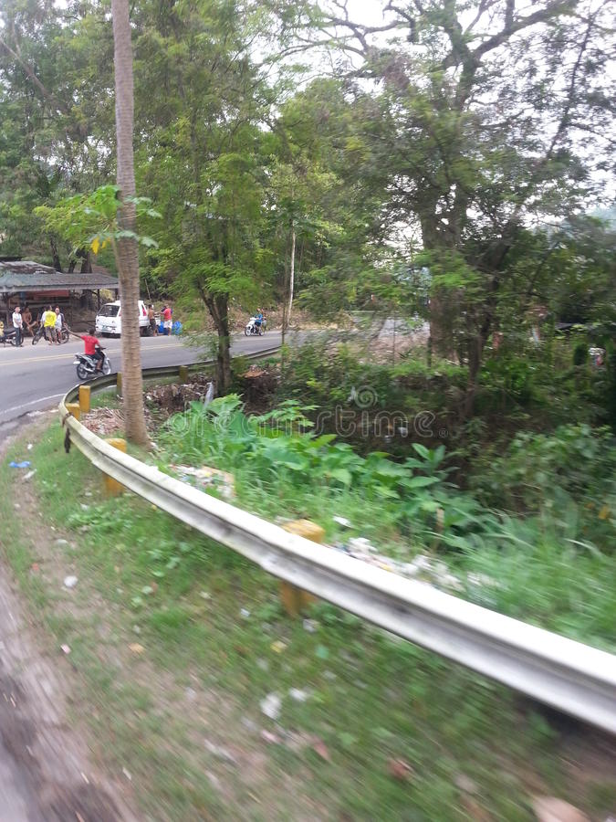 A sharp turn of the mountain road on the island of Cebu Philippines stock photo