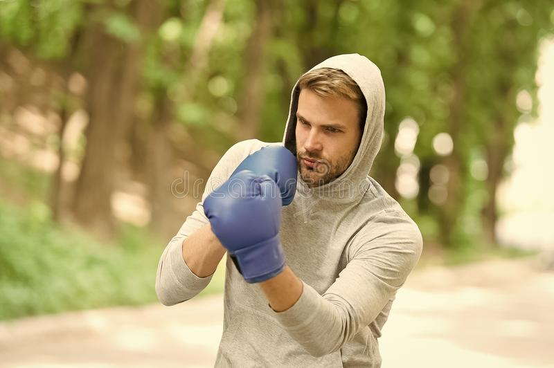 Sharpen his skill. Sportsman concentrated training boxing gloves. Athlete concentrated face sport gloves practice stock photos