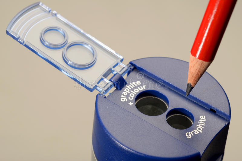 Sharpen your pencil. Pencil sharpener and sharpened pencil. Metaphor for sharpen your pencil royalty free stock image