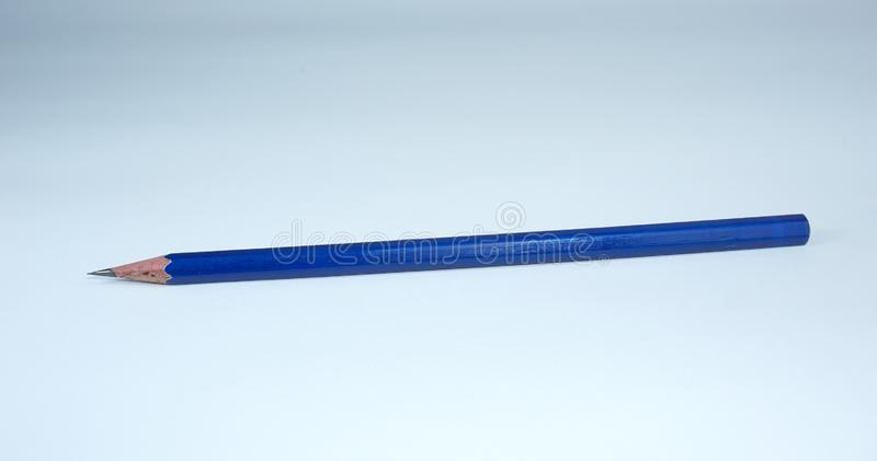 Sharpened blue pencil on white background royalty free stock photos