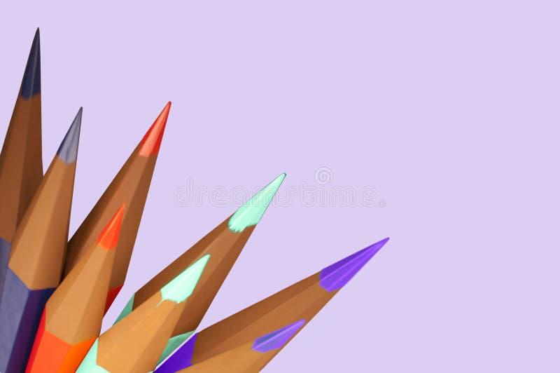 Sharpened Color Pencils On Side Of Lavendar Sheet Stock Images